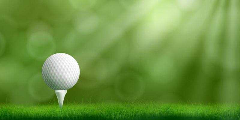 Grass, ball and tee