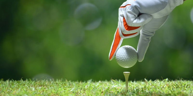 golf ball and players hand - best golf balls for slow swing speed